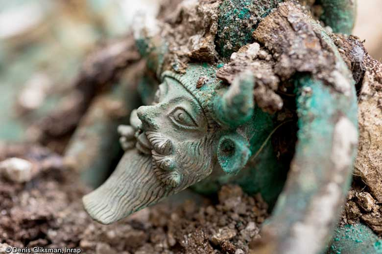 Handle of a bronze cauldron representating the Greek God Achelous. © Denis Gliksman, Inrap