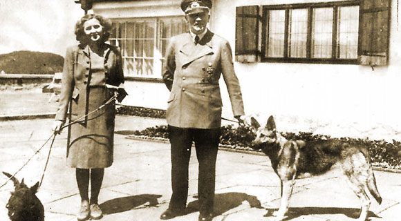 Adolf Hitler and Eva Braun with their dogs Blondi and Bella